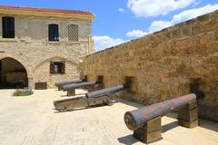 old guns in castle - stock photo