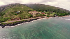 Aerial fly away from a Hawaiian beach with waves breaking - stock footage