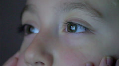 Closeup shot of boy eyes watching television at night Stock Footage