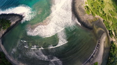 Aerial Looking At Colorful Waves Breaking on a Molokai, Hawaii Beach Stock Footage