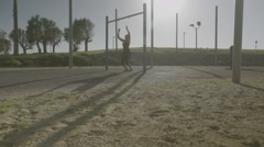 Young woman doing pull-ups Stock Footage