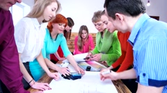 Creative team in a multi-colored clothes to create a design project. Stock Footage
