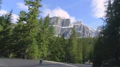 Fast driving through the winding road from the peak to down in Dolomites, Italy Stock Footage