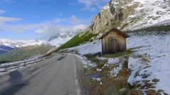 Driving from the Sass Pordoi peak in the Dolomites with marmot running Stock Footage
