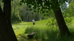 Children's Day Opole Worker Mows Green Grass Rural Landscape Cottages in Park Stock Footage