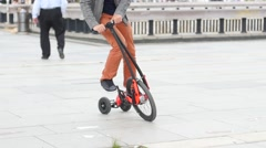 People riding halfbike - new trendy way to cycle city slow motion Stock Footage