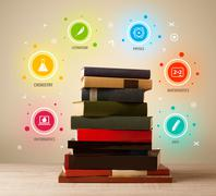 Books on top with colorful symbols on vintage background - stock photo