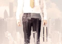 Handsome business man with overlay cityscape - stock photo