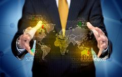 Business person holding earth statistics map - stock photo
