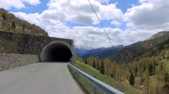 Speeding car on the serpentine through the tunnel in the Dolomites Stock Footage