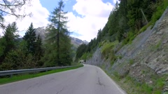 Driving a car through the winding road to Caprile in the dolomites, Italy Stock Footage
