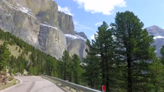 Driving a car through the winding road in the dolomites, Italy Stock Footage