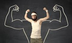 Young weak man with drawn muscles - stock photo