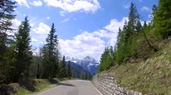 Speeding car on the serpentine in the Dolomites, Italy Stock Footage
