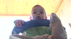 Baby boy in stroller - stock footage
