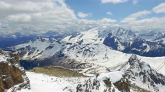 View of the valley from the summit of Sass Pordoi in the Dolomites Stock Footage