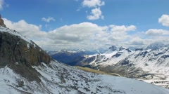 Travel with cable car to summit of Sass Pordoi view to the valley, Dolomites Stock Footage