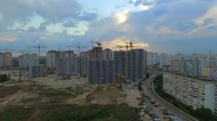 Aerial. Construction site with many cranes at a big city. Sunset time Stock Footage