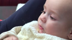 Baby chewing a baby swab Stock Footage