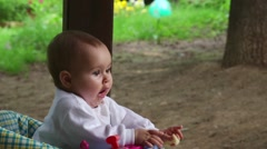 Baby eating in a baby stroller - stock footage