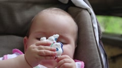 Baby Girl Chewing Her Toy 01 Stock Footage
