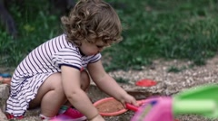 Baby Girl Playing In Sand Outdoors Stock Footage
