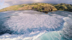 Aerial following the breaking ocean waves towards the shore on Molokai, Hawaii Stock Footage