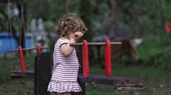 Baby Girl Playing With Seesaw, Flip-Flop - stock footage