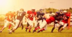 Blurred background of american football game - stock photo