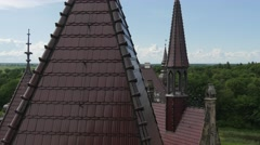 Roofs and Towers of Moszna Castle Park Lawns Green Trees on a Horizon Sunny Day Stock Footage