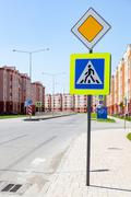 Traffic signs main road and pedestrian crossin Stock Photos