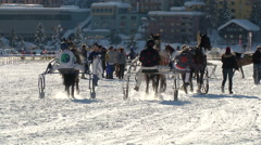 Trotters and horses St.Moritz Grand Prix in slow motion Stock Footage
