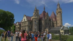 Excursion in Moszna Castle Poland People Filming Standing in a Line Eclectic Stock Footage