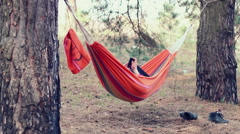Hammock relax. Young woman using smart phone in hammock at forest Stock Footage
