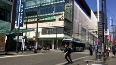 People walking and crossing the street at downtown Vancouver - stock footage