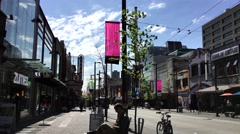 People walking and crossing the street at downtown Vancouver with 4k resolution. - stock footage