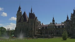 People Fountain in Moszna Castle Courtyard Eclectic Styled Building Park Lawns Stock Footage