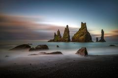 Black beach Reynisfjara at sunrise, Iceland Stock Photos