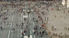 People walking, taking a stroll in Piazza Duomo square, Milan, Italy Arkistovideo