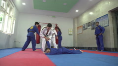 Boys and girls practicing real aikido in the gym by Pakito. - stock footage