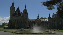 Tourists Fountain in Moszna Castle Courtyard Eclectic Styled Building Park Stock Footage