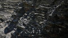 Closeup of a sedimentary mountain limestone rocks texture Stock Photos