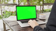 Man working on computer at cafe green screen key 4K stock video footage Stock Footage