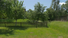 Ancient House With Birches Behind the Fence Stock Footage