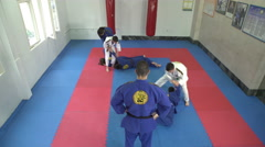 Teens practicing aikido in the gym by Pakito. - stock footage