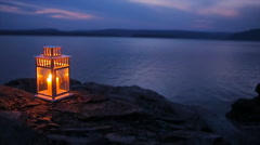 candle flame shines on the lake - stock footage