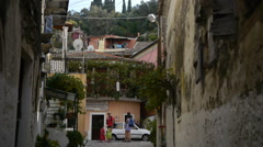 tourists, families with children are on the street of the old small town - stock footage