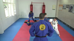 Real aikido training in the exercise room, crane shot by Pakito. Stock Footage