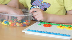 Little child plays a intellectual game at a table - stock footage