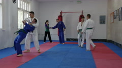 Boys and girls practicing on the real aikido training by Pakito. - stock footage